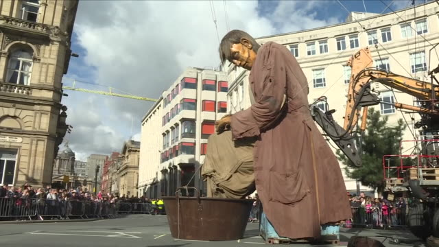 exterior view of the giant man oversized giant marionette sitting down and taking a rest in liverpool town centre on october 06, 2018 in liverpool,... - puppet stock videos & royalty-free footage