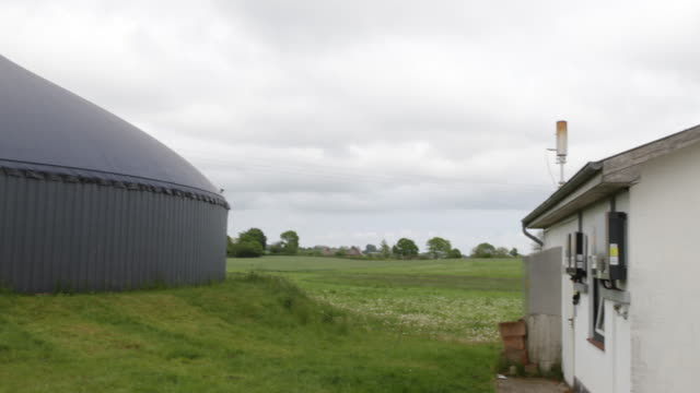 exterior view of the memory of a biogas plant in northern germany in schleswig -holstein - schleswig holstein stock videos & royalty-free footage