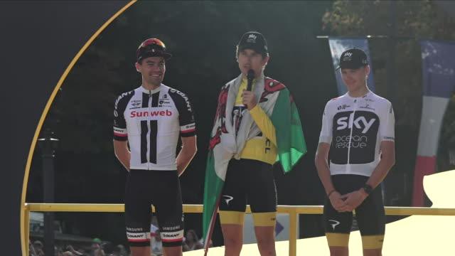 Exterior view of Tour de France winner Geraint Thomas Tom Dumoulin and Chris Froome on the winners podium on the Avenue des ChampsÉlysée and Geraint...