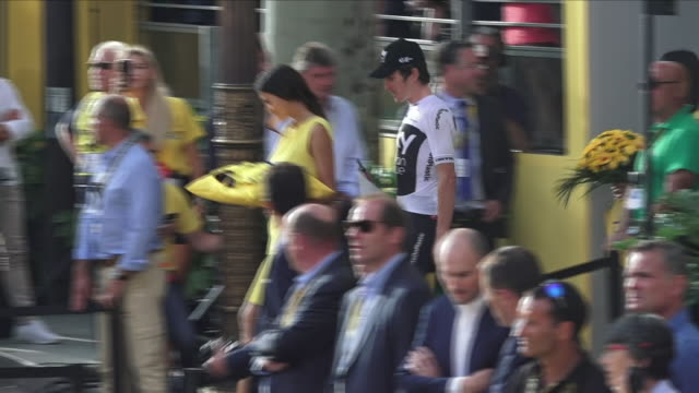 Exterior view of Tour de France winner Geraint Thomas walking out to the podium for the awards ceremony on the Avenue des ChampsÉlysée on July 29...