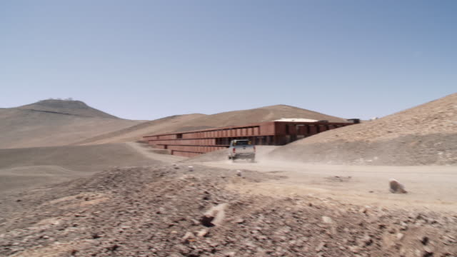 CS Exterior view of VLT Residencia with telescopes in distance at Paranal Observatory, Chile