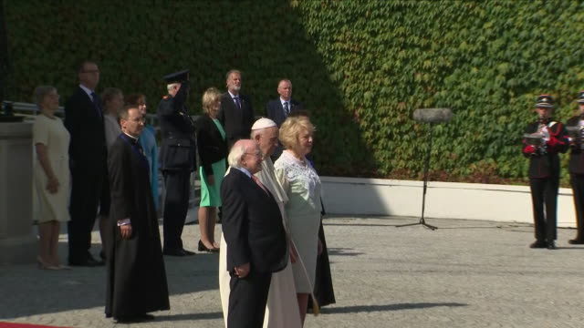 exterior views as pope francis and irish president michael d higgins and his wife stand for the irish national anthem on the red carpet outside the... - michael d. higgins stock videos and b-roll footage