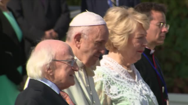 exterior views as pope francis and irish president michael d higgins and his wife stand for the vatican city national anthem on the red carpet... - ヴァチカン市国点の映像素材/bロール