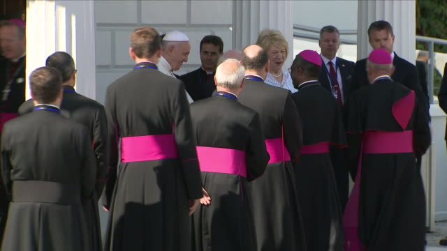 exterior views as pope francis and irish president michael d higgins and his wife greet clerics and dignitaries and members of the military outside... - michael d. higgins stock videos and b-roll footage