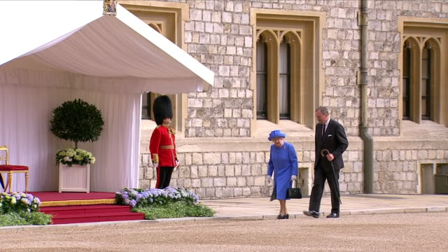 exterior views hm queen elizabeth ii as she walks up to podium and the national anthem is played in windsor castle courtyard as she prepares to meet... - windsor castle stock videos & royalty-free footage
