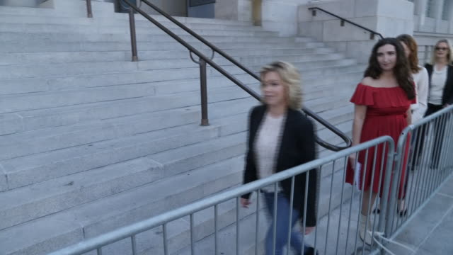 exterior views of 9 of the silence breakers, accusers of harvey weinstein walking to the podium outside los angeles city hall before they hold a... - rosanna arquette stock videos & royalty-free footage