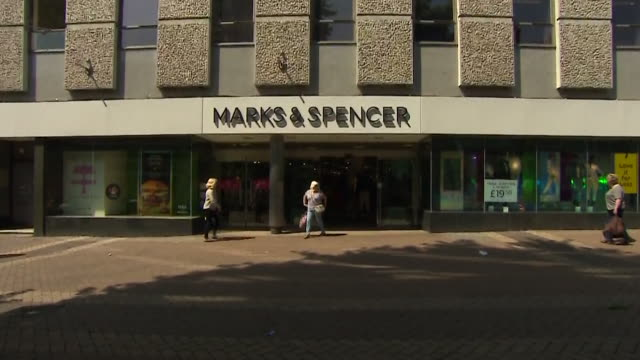 exterior views of a marks spencer store - entrance sign stock videos & royalty-free footage