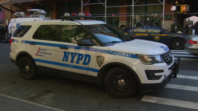 exterior views of a nypd police patrol car parked outside the tribeca grill restaurant including close ups of siren badge and signage and us flag... - siren stock videos and b-roll footage