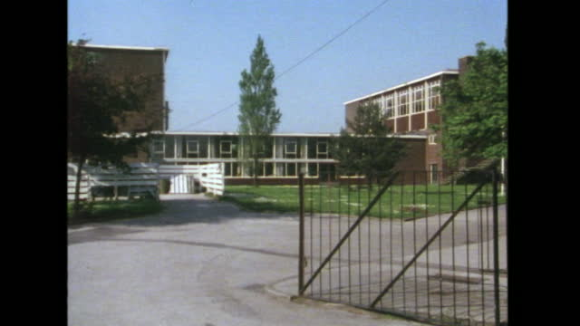 exterior views of a post-war secondary school building on a sunny day, manchester, uk; 1988. - wide shot stock videos & royalty-free footage