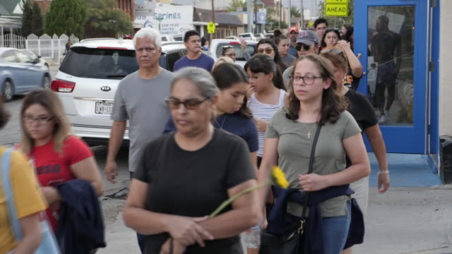 exterior views of a silent vigil, as people walk through the streets of el paso as they mourn the victims of the mass shooting on 5 august, 2019 in... - memorial vigil stock videos & royalty-free footage