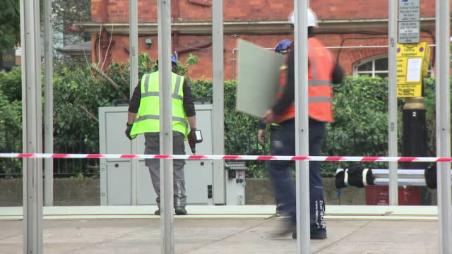 exterior views of a temporary mortuary being constructed at westminster coroners court, showing builders at work on 18 march 2020 in london, united... - construction industry stock videos & royalty-free footage