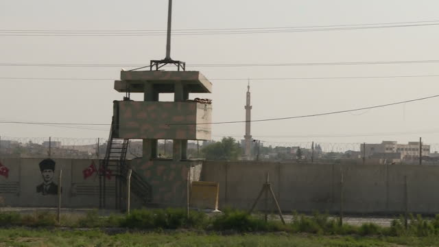 exterior views of a turkish border post and wall with barbed fence looking towards syria on 9 october 2019 in sanliurfa turkey - surrounding wall stock videos & royalty-free footage