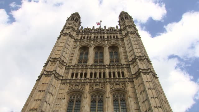 exterior views of a union jack flag flying on victoria tower palace of westminster on 16 july 2019 in london united kingdom - victoria tower stock-videos und b-roll-filmmaterial