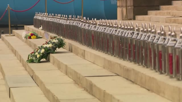 exterior views of a wreath amd 96 candles in a line on the steps of stgeorges hall a fan lays a scarf as it marks 30 years since the hillsborough... - hillsborough disaster stock videos and b-roll footage