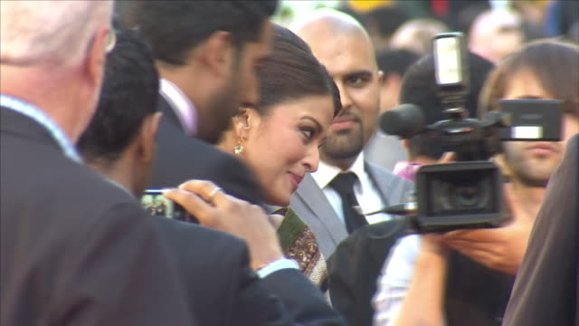 exterior views of aishwarya rai bachchan husband abhishek bachchan on the red carpet at the premiere of film ravaan at bfi southbank surrounded by... - bfi southbank stock videos & royalty-free footage