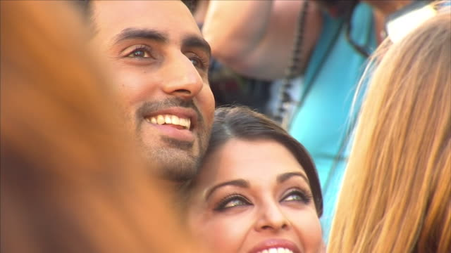 exterior views of aishwarya rai bachchan & husband abhishek bachchan on the red carpet at the premiere of film ravaan at bfi southbank surrounded by... - bfi southbank stock videos & royalty-free footage