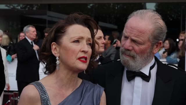 exterior views of an interview on the bafta tv awards red carpet with leslie manville and peter mullan talking about their tv series mum in london... - british academy television awards stock videos & royalty-free footage