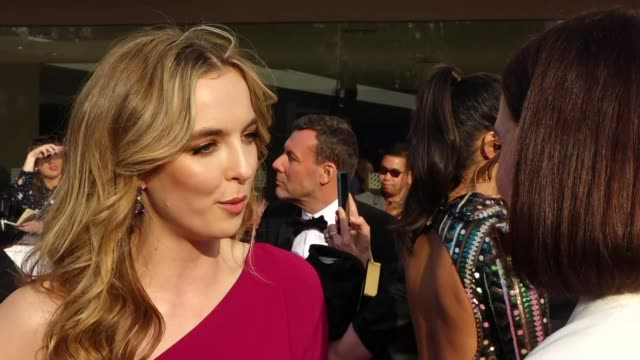 exterior views of an interview with actress jodie cromer talking about the tv series killing eve on the bafta tv awards red carpet outside the royal... - royal festival hall stock videos & royalty-free footage