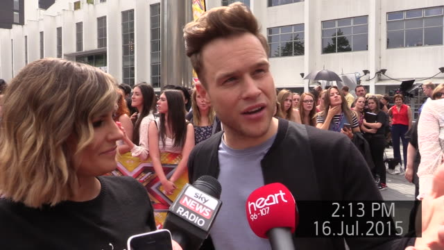exterior views of an interview with caroline flack and olly murs, presenters of the x factor at auditions for the show at sse arena on 17 july 2015... - ウェンブリーアリーナ点の映像素材/bロール