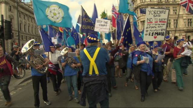 exterior views of antbrexit protesters marching down whitehall towards parliament led by a yorkshire brass band on 3 september 2019 in london united... - brass band stock videos & royalty-free footage