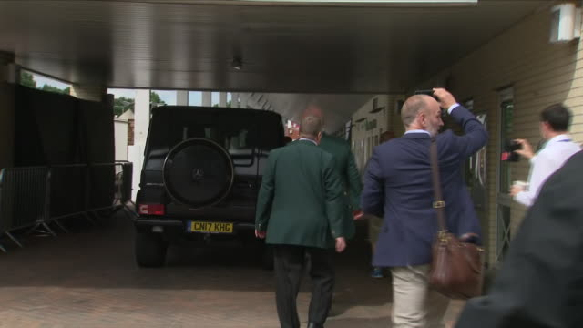 exterior views of ben stokes as he arrives at trent bridge cricket ground in his car and followed by press and media pack and exits his car and... - 後を追う点の映像素材/bロール
