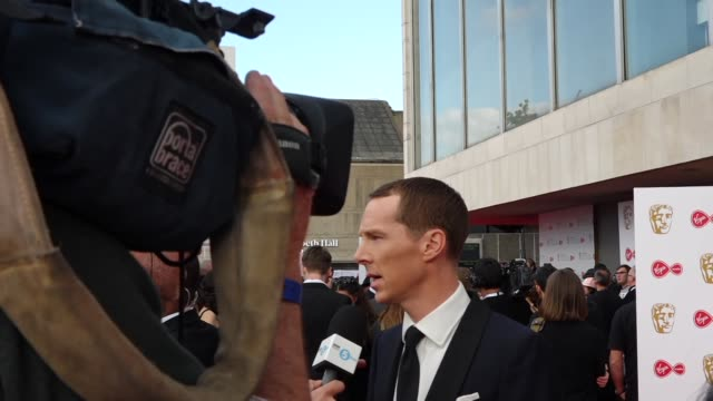 exterior views of benedict cumberbatch being interviewed by press and tv cameras on the bafta tv awards red carpet outside the royal festival hall on... - british academy television awards stock videos & royalty-free footage