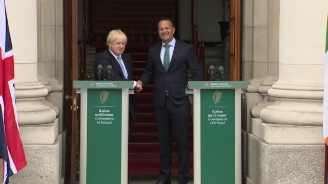 exterior views of boris johnson and leo varadkar shaking hands and walking into government building after a joint press conference on 9 september... - leo varadkar stock videos and b-roll footage