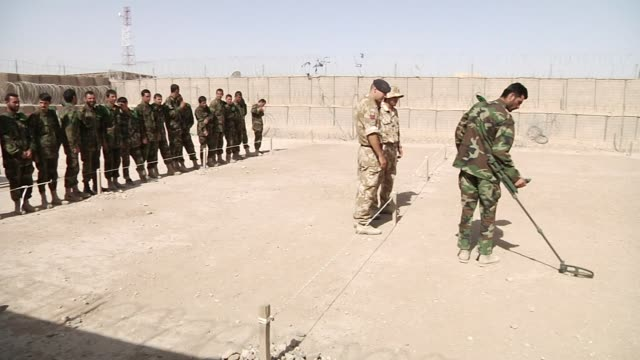exterior views of britsih army soldiers training afghan army soldiiers in land mine detection using detectors on 1 june 2010 in lashkar gah... - land mine stock videos and b-roll footage