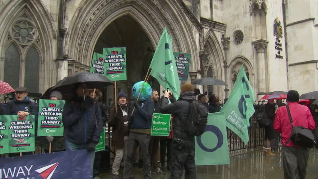 exterior views of campaigners outside the royal courts of justice, as they wait for the result of their appeal about the third runway at heathrow,... - papier stock videos & royalty-free footage