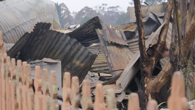 exterior views of charred remains of a rural cafe restaurant as bushfires rage uncontrolled in new south wales in bilpin in sydney on 22 december 2019 - damaged stock videos & royalty-free footage