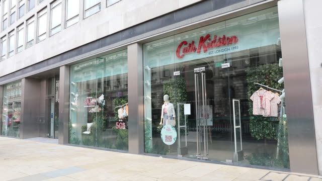 exterior views of closed stores and restaurants amid retail closures in uk. shops that have ceased trading in the u.k. include oasis, warehouse,... - incidental people stock videos & royalty-free footage