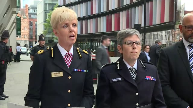 exterior views of commander baxter of the city of london and cressida dick, commissioner of the metropolitan police walking out from the old bailey... - police statement stock videos & royalty-free footage