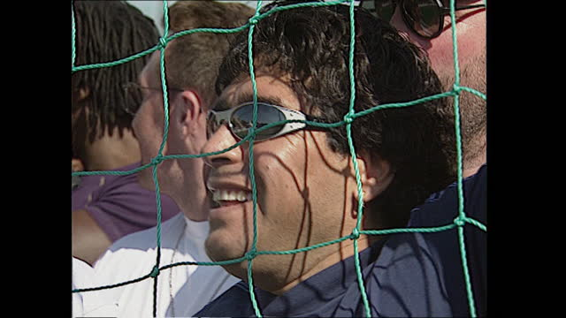 exterior views of diego maradona attending the world junior football finals at battersea park, including watching a game through netting surrounded... - battersea park stock videos & royalty-free footage