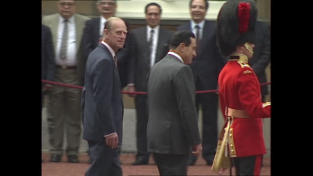exterior views of egypt president hosni mubarak and prince philip inspecting a regiment of coldstream guards in buckingham palace courtyard and being... - president of egypt stock videos & royalty-free footage