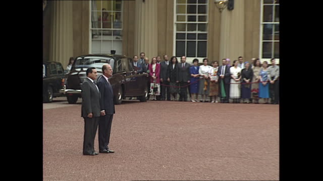 exterior views of egypt president hosni mubarak and prince phillip walking in buckingham palace courtyard and standing for egyptian national anthem... - president of egypt stock videos & royalty-free footage