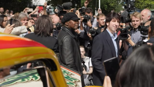 exterior views of four lookalikes from the fab four beatles tribute band surrounded by press and fans as they attempt to recreate the iconic cover... - zebra crossing stock videos & royalty-free footage