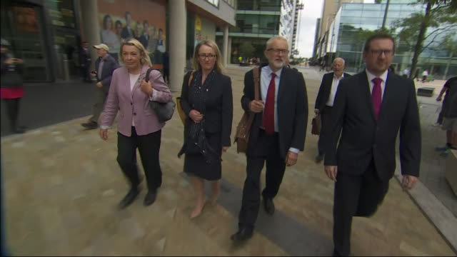 exterior views of jeremy corbyn, john mcdonnell and members of the shadow cabinet departing salford and being followed by press and media on 2... - cabinet member stock videos & royalty-free footage
