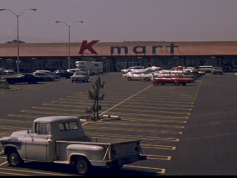 1971 exterior views of kmart store and parking lot - consumerism stock videos & royalty-free footage