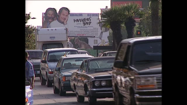 exterior views of los angeles, including views of sunset boulevard street sign, and views from hollywood hills and busy traffic on 3 june 1997 in los... - sunset boulevard stock-videos und b-roll-filmmaterial