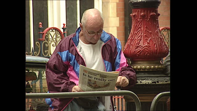 exterior views of onlookers and police outside the landmark hotel in marylebone, including people looking at euro 96 programmes and reading... - 1996 stock videos & royalty-free footage