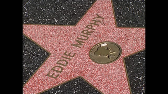 exterior views of people on hollywood boulevard, including views of eddie murphy's star on the hollywood walk of fame on 3 june 1997 in los angeles,... - walk of fame stock videos & royalty-free footage