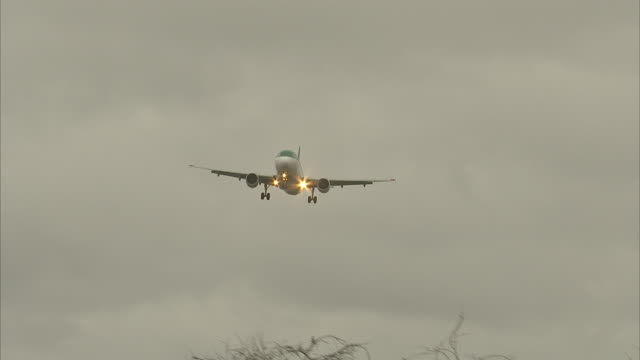exterior views of planes coming into land at heathrow airport as it is buffeted by the strong winds of storm dennis on 15 february 2020 in london,... - landing touching down stock videos & royalty-free footage