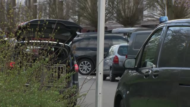 exterior views of police and counter terrorism activity outside a possible suspects house including officers getting ready for a search and a dog... - utrecht stock videos & royalty-free footage
