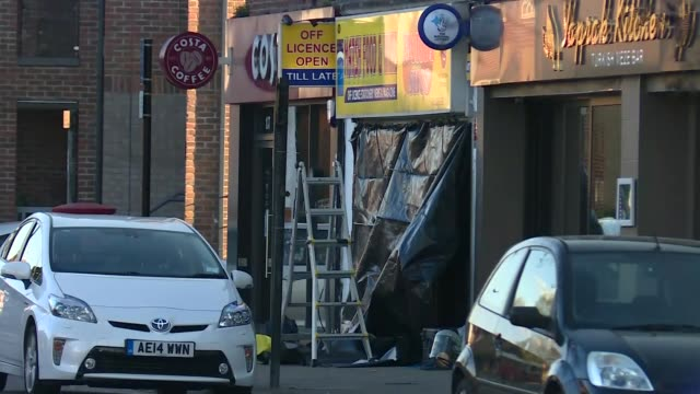 exterior views of police at stabbing crime scene in pinner including forensic tent on pavement outside a newsagents shop and parade of shops on high... - flash stock videos & royalty-free footage