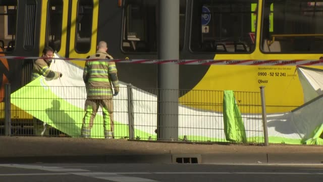 exterior views of police fire and rescue services at the scene of a shooting on a tram including a erecting a forensic tent near the tram and... - utrecht stock videos & royalty-free footage