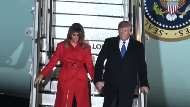 exterior views of president trump and first lady melania disembarking from air force one after landing at stansted airport for the nato leaders... - walking stock videos & royalty-free footage