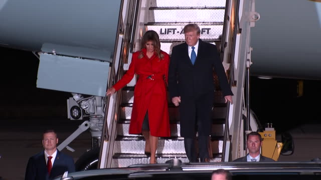 exterior views of president trump and first lady melania disembarking from air force one after landing at stansted airport for the nato leaders... - melania trump stock videos & royalty-free footage