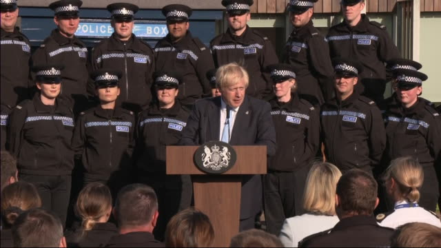 exterior views of prime minister boris johnson as he continues his speech at a police training centre including trying to recite the police caution... - safety stock videos & royalty-free footage