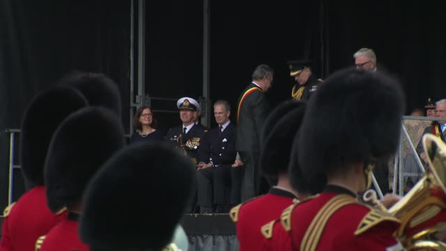 clean exterior views of prince andrew attending the commemorations marking the 75th anniversary of the liberation of bruges in the main town square... - ヨーク公 アンドルー王子点の映像素材/bロール