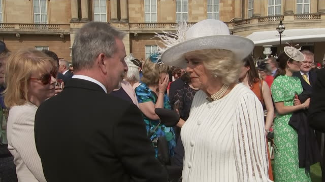 exterior views of prince charles and camilla the duchess of cornwall talking with guests at the first royal garden party of the year in the... - royalty stock videos & royalty-free footage